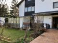 Wintergarten mit vorderem Gartenanteil