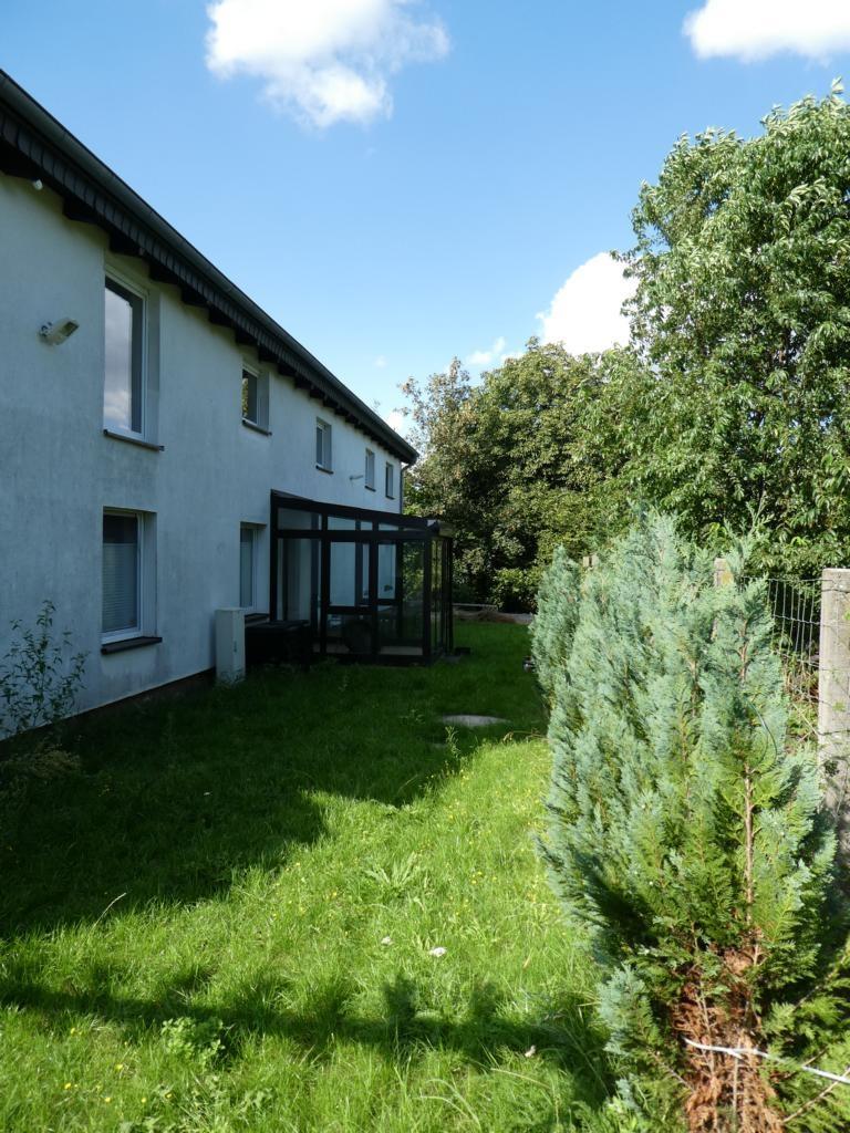 14 Rückseite Wohnhaus mit Wintergarten