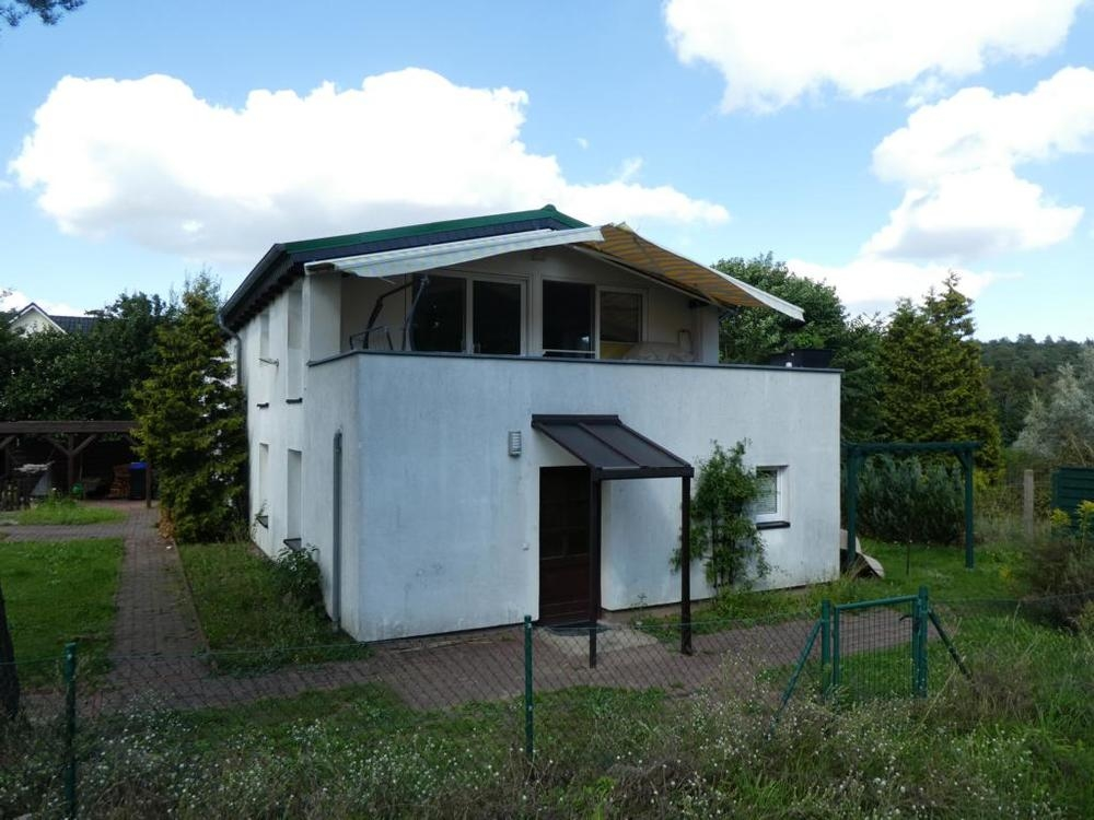 2 Südgiebel mit Terrasse und Eingang Einliegerwohnung