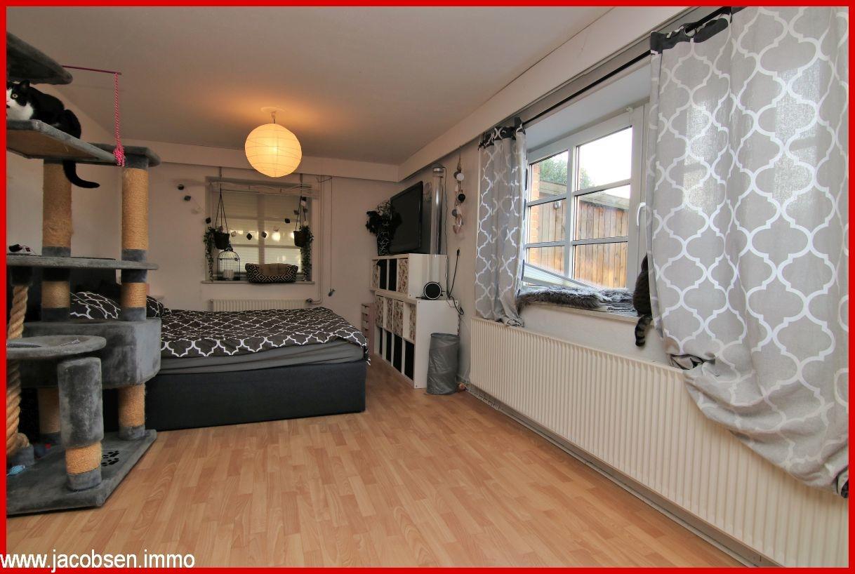 Wohnzimmer/ im Grundriss Schlafzimmer im Souterrain