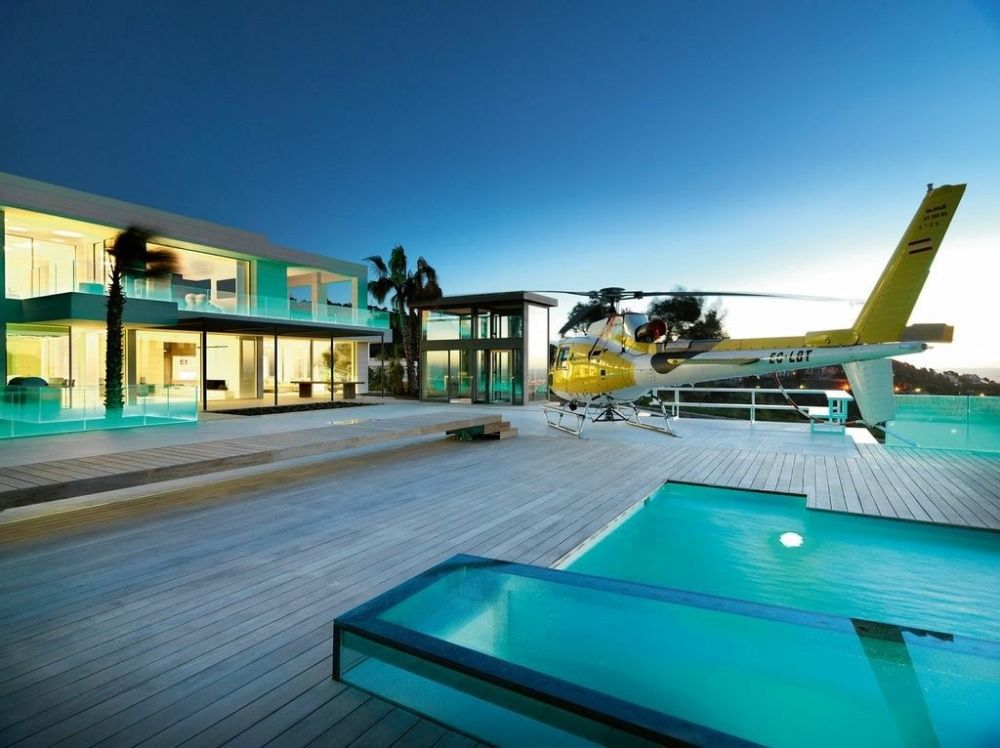 terrace and pool with helicopter