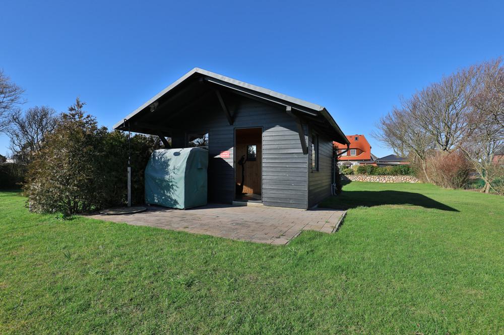 Blockhütte mit Sauna und FItnessraum