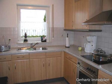 Die Küche mit Einbauküche