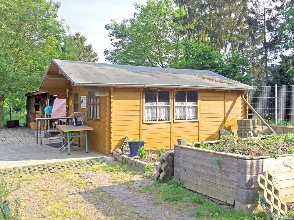 Gartenhaus & Hochbeete