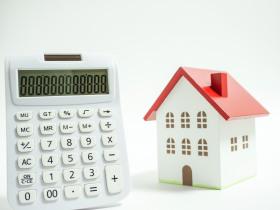 Haus und Taschenrechner