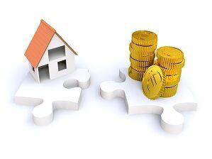 Puzzleteile mit Haus und Münzen