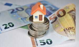 Hausmodell mit Geld