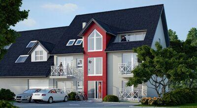 Mehrfamilienhaus mit Balkon und Parkplätzen