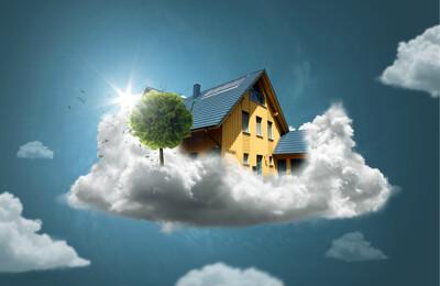 Haus schwebt auf einer Wolke
