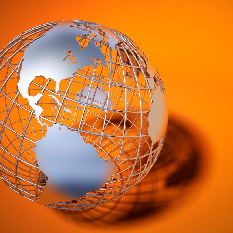 A metal mesh globe showing predominately North and South America. 3D render with HDRI lighting and raytraced textures.