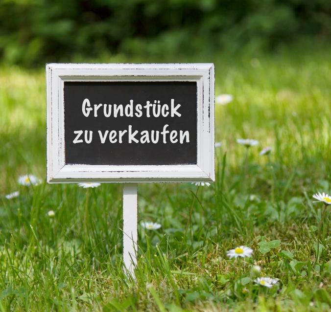 Schild Grundstück zu verkaufen